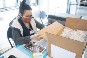 CRAIG T. KOJIMA / APRIL 15                                 Cindy Khamphaphanh prepares syringes with the Moderna coronavirus vaccine at the Times Pharmacy in Mililani.
