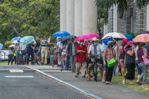 CRAIG T. KOJIMA / APRIL 28                                 People standing in line in the rain to receive food on Wednesday at the Central Union Church Food Distribution program. Many people have been facing food insecurity as a result of the coronavirus pandemic.