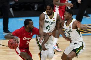 ASSOCIATED PRESS                                 Houston guard DeJon Jarreau (3) drives around Baylor guard Davion Mitchell (45) and guard Jared Butler (12) during the first half of a men's Final Four NCAA college basketball tournament semifinal game on Saturday in Indianapolis.