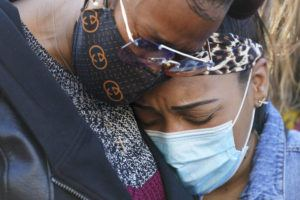 ASSOCIATED PRESS                                 DMX'S ex-wife Tashera Simmons, left, and his fiancé Desiree Lindstrom embrace during a prayer vigil outside of White Plains Hospital today in White Plains, N.Y. Supporters and family of the rapper DMX have chanted his name and offered up prayers outside the hospital where he remains on life support. The 50-year-old was admitted to the hospital following a heart attack.