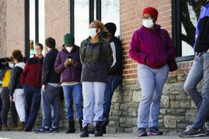 ASSOCIATED PRESS                                 People wearing face masks as a precaution against the coronavirus waited in line to receive COVID-19 vaccines at a site in Philadelphia. Nearly half of new coronavirus infections nationwide are in just five states, including Pennsylvania — a situation that puts pressure on the federal government to consider changing how it distributes vaccines by sending more doses to hot spots.