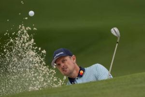 ASSOCIATED PRESS                                 Justin Rose, of England, hits out of a bunker on the seventh hole during the second round of the Masters golf tournament today in Augusta, Ga.