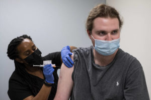 ASSOCIATED PRESS                                 Cole Smith received a Moderna variant vaccine shot from clinical research nurse Tigisty Girmay at Emory University's Hope Clinic, March 31, in Decatur, Ga. Smith, who received Moderna's original vaccine a year ago in a first-stage study, said returning wasn't a tough decision.