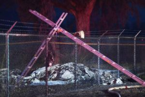 STAR-ADVERTISER FILE                                 Part of the wreckage of a twin-engine Beechcraft King Air plane lies on the ground after a fatal crash near the chain link fence surrounding Dillingham Airfield on June 21, 2019.
