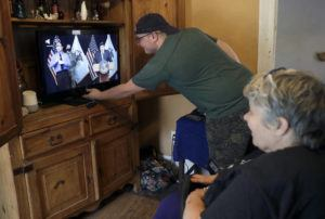 ASSOCIATED PRESS                                 Zach Stafford adjusts the volume as he and his mother, Debra Mize, right, watch a livestream of the daily coronavirus briefing by Illinois Gov. J.B. Pritzker on a television inside their home on April 28, 2020, in Belleville, Ill. Television networks are grumbling that the Nielsen company is not accurately measuring how many people are watching their programs. Networks believe that it's counter-intuitive that fewer people are watching TV at a time the pandemic is keeping so many at home. Nielsen says that after an initial burst of interest last spring, long-term trends taking people away from TV have re-emerged, including increased numbers of people spending time on their devices, or listening to podcasts.