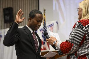 STAR TRIBUNE VIA AP                                 Mike Elliott takes the oath of office as the city's new mayor with city clerk Barb Suciu, right, during Elliot's inauguration ceremony on Jan. 2, 2019, at the Brooklyn Center Community Center, in Brooklyn Center, Minn. Elliott is the city's first Black and first Liberian American mayor.