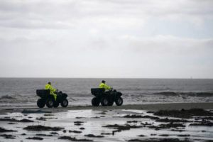 ASSOCIATED PRESS / APRIL 15                                 Lafourche Parish deputies patrol along the shoreline of the Gulf of Mexico, not far from where a lift boat capsized during a storm on Tuesday, killing one with 12 others still missing, on Elmer's Island, La.
