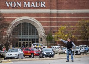 CHRIS MACHIAN/OMAHA WORLD-HERALD VIA AP                                 Law enforcement directs traffic away after a shooting at Westroads Mall in Omaha, Neb. Shots rang out Saturday in the mall, leaving one person critically wounded and sending shoppers running for the exit.