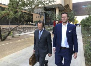 ASSOCIATED PRESS                                 Then-Maricopa County Assessor Paul Petersen, right, and his attorney, Kurt Altman, left a court hearing, in Nov. 2019, in Phoenix. The former Arizona politician could serve up to 15 years in prison for operating an illegal adoption scheme involving women from the Marshall Islands after he was given his third sentence, today, in Utah.