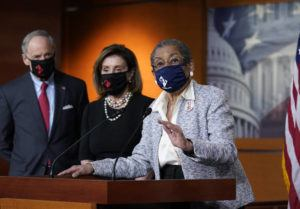 ASSOCIATED PRESS                                 Del. Eleanor Holmes-Norton, D-D.C., center, joined from left by Sen. Tom Carper, D-Del., and House Speaker Nancy Pelosi, D-Calif., spoke at a news conference ahead of the House vote on H.R. 51- the Washington, D.C. Admission Act, on Capitol Hill in Washington.