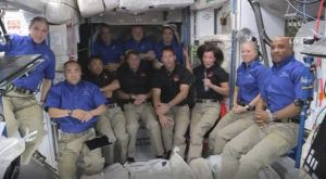 NASA VIA AP                                 Astronauts from SpaceX join the astronauts of the International Space Station for an interview. A recycled SpaceX capsule carrying four astronauts has arrived at the International Space Station, a day after launching from Florida. The Dragon capsule docked autonomously with the orbiting outpost on Saturday.