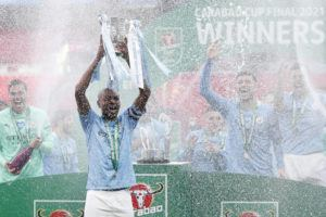 ASSOCIATED PRESS                                 Manchester City's team captain Fernandinho lifts the trophy at the end of the English League Cup final soccer match between Manchester City and Tottenham Hotspur at Wembley stadium in London, today. Manchester City won 1-0.