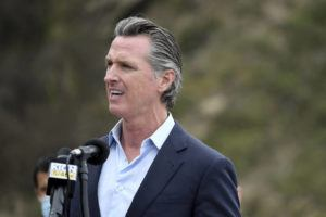 ASSOCIATED PRESS                                 California Gov. Gavin Newsom speaks during a press conference about the newly reopened Highway 1 at Rat Creek near Big Sur, Calif., on Friday.