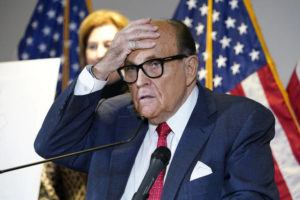 ASSOCIATED PRESS                                 Former New York Mayor Rudy Giuliani, who was a lawyer for President Donald Trump, spoke, Nov. 19, during a news conference at the Republican National Committee headquarters in Washington. Federal investigators in Manhattan executed a search warrant today at the Upper East Side apartment of Rudy Giuliani.