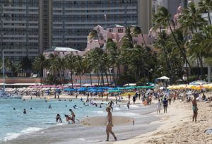 CINDY ELLEN RUSSELL / APRIL 5                                 Beachgoers crowded the sands of Waikiki on a recent Monday afternoon. With the increasing prevalence of vaccinations and COVID-19 testing, more and more tourists are returning to Hawaii.