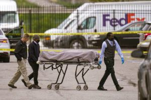 ASSOCIATED PRESS                                 A body is taken from the scene where multiple people were shot at a FedEx Ground facility in Indianapolis. A gunman killed several people and wounded others before taking his own life in a late-night attack at a FedEx facility near the Indianapolis airport, police said.