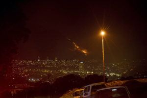 ASSOCIATED PRESS                                 Residential neighborhoods are lit by raging fires in Cape Town, South Africa, today.
