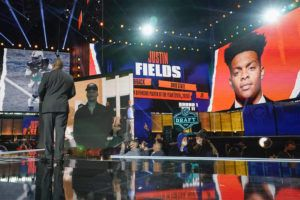 ASSOCIATED PRESS                                 An image of Ohio State quarterback Justin Fields is displayed after he was chosen by the Chicago Bears with the 11th pick in the first round of the NFL Draft.
