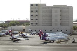 GEORGE F. LEE / 2020                                 Parked Hawaiian Airlines plane on the apron adjacent to Federal Detention Center at Daniel K. Inouye International Airport.