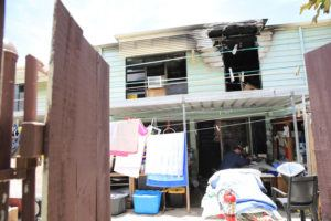 JAMM AQUINO / JAQUINO@STARADVERTISER.COM                                 Fire investigators work on the scene of the aftermath of a house fire that claimed a second floor unit on Helelua Street today.