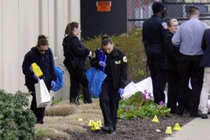 NEW YORK TIMES                                 Crime scene technicians investigate the scene today at a Fedex facility in Indianapolis where a mass shooting occurred Thursday night.