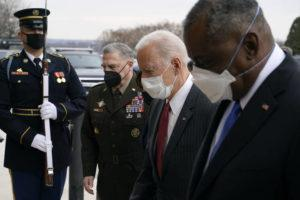 ASSOCIATED PRESS                                 President Joe Biden walked with Joint Chiefs Chairman Gen. Mark Milley, second from left, and Defense Secretary Lloyd Austin as he arrived at the Pentagon in Washington. Milley says he is now open to considering a proposal to take decisions on sexual assault prosecution out of the hands of military commanders.