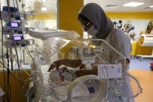 ASSOCIATED PRESS                                 A Moroccan nurse took care of one of the nine babies protected in an incubator at the maternity ward of the private clinic of Ain Borja in Casablanca, Morocco, Wednesday. A Malian woman gave birth to nine babies after expecting only seven.