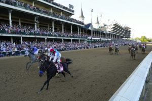 ASSOCIATED PRESS                                 John Velazquez riding Medina Spirit leads Florent Geroux on Mandaloun, Flavien Prat riding Hot Rod Charlie and Luis Saez on Essential Quality to win the 147th running of the Kentucky Derby at Churchill Downs on May 1 in Louisville, Ky.