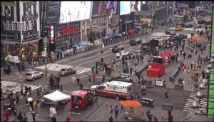 ASSOCIATED PRESS                                 In this image taken from video by the FDNY, pedestrians hurry away from the scene of a shooting in Times Square, Saturday, in New York. New York City police say three innocent bystanders including a 4-year-old girl who was toy shopping were shot. All the victims are expected to recover.