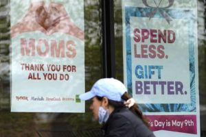 ASSOCIATED PRESS                                 Signs about Mother's Day are displayed at a home decor department store in Northbrook, Ill., Saturday.