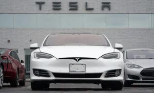 ASSOCIATED PRESS                                 Vehicles at a Tesla location, Sunday, in Littleton, Colo. According to the U.S. National Transportation Safety Board, home security camera footage shows that the owner of a Tesla got into the driver's seat of the car shortly before a deadly crash in suburban Houston.