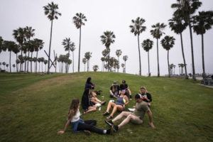 ASSOCIATED PRESS                                 A group of friends, who said they are fully vaccinated for COVID-19, mingle on the beach in the Venice section of Los Angeles last Wednesday.