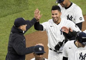ASSOCIATED PRESS                                 New York Yankees' Gleyber Torres is congratulated by manager Aaron Boone after Torres drove in the winning run in the 11th inning of the team's baseball game against the Washington Nationals on Saturday at Yankee Stadium in New York. The Yankees won 4-3.