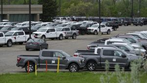 ASSOCIATED PRESS                                 Ford pickup trucks built lacking computer chips were shown in parking lot storage in Dearborn, Mich., May 4. Automakers are cutting production as they grapple with a global shortage of computer chips, and that's making dealers nervous.