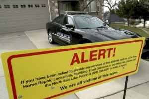 COURTESY LAURA SEITZ/THE DESERT NEWA VIA AP / 2019                                 A warning sign and a police officer's vehicle at Walt Gilmore's home in North Salt Lake, Utah.