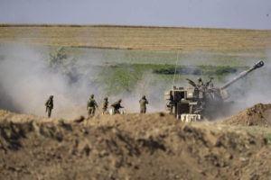 ASSOCIATED PRESS                                 An Israeli artillery unit fires toward targets in Gaza Strip, at the Israeli Gaza border, today.