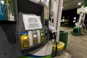 ASSOCIATED PRESS                                 A pump at a gas station in Silver Spring, Md., is out of service, notifying customers they are out of fuel on Thursday.