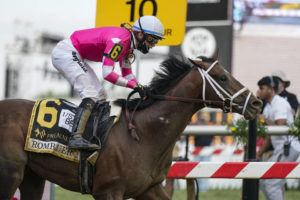ASSOCIATED PRESS                                 Flavien Prat atop Rombauer reacts as he crosses the finish line to win the Preakness Stakes horse race at Pimlico Race Course today in Baltimore.