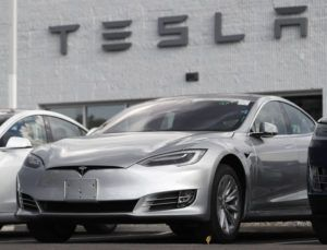 ASSOCIATED PRESS / JULY 8, 2018                                 Tesla 2018 Model 3 sedans sit on display outside a Tesla showroom in Littleton, Colo., in 2018. The driver of a Tesla Model 3 involved in a fatal crash that California highway authorities said may have been on operating on Autopilot posted social media videos of himself riding in the vehicle without his hands on the wheel or foot on the pedal. The May 5 crash in Fontana, east of Los Angeles, is also under investigation by the National Highway Traffic Safety Administration.