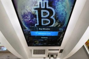 ASSOCIATED PRESS                                 The Bitcoin logo appeared on the display screen of a cryptocurrency ATM, Feb. 9, at the Smoker's Choice store in Salem, N.H. The price of Bitcoin fell as much as 29% today, after the China Banking Association warned members of risks associated with digital currencies.
