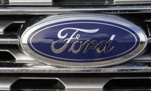 ASSOCIATED PRESS / APRIL 25                                 The blue oval logo of Ford Motor Company is shown in east Denver.