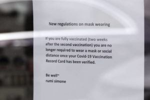 ASSOCIATED PRESS / MAY 21                                 A sign at a spa and beauty salon in Lake Oswego, Oregon, advises that only customers who can prove they are fully vaccinated may enter without masks on. As the federal government and many states ease rules around mask-wearing and business occupancy, some blue states like Oregon and Washington are still holding on to some longtime coronavirus restrictions.
