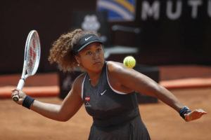 ASSOCIATED PRESS                                 Naomi Osaka of Japan returned the ball to Jessica Pegula of the United States during their match at the Italian Open tennis tournament, in Rome, May 12. Osaka lost against Pegula 7-6, 6-2.
