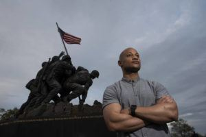 """ASSOCIATED PRESS                                 Reserve Marine Maj. Tyrone Collier visited the U.S. Marine Corps War Memorial near his home in Arlington, Va., on April 17. When Collier was a newly minted second lieutenant and judge advocate, he recalls a salute to him from a Black enlisted Marine. But even after Collier acknowledged the gesture, the salute continued. Puzzled, Collier asked why the Marine held it for so long. """"He said, 'Sir, I just have to come clean with something. … We never see Black officers. We never see people like you and it makes me extraordinarily proud,'"""" Collier recalls."""