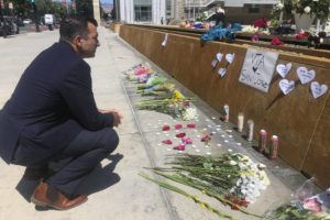 ASSOCIATED PRESS                                 San Jose Mayor Sam Liccardo stops to view a makeshift memorial for the rail yard shooting victims in front of City Hall in San Jose, Calif.