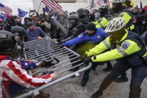 ASSOCIATED PRESS / JAN. 6                                 Supporters of then-President Donald Trump beset a police barrier at the Capitol in Washington on Jan. 6.