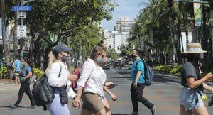 JAMM AQUINO / MAY 4                                 Pedestrians wearing masks walk on Kalakaua Avenue in Waikiki last week.