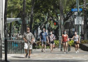 JAMM AQUINO / MAY 4                                 Pedestrians wearing masks walk on Kalakaua Avenue in Waikiki. On Thursday, Gov. David Ige announced that Hawaii's mask mandate would remain in place despite new CDC guidelines that say fully vaccinated people can forego masks in most circumstances.