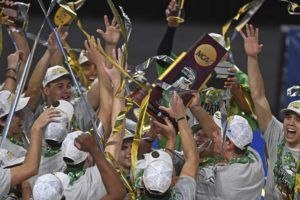 ASSOCIATED PRESS                                 Hawaii team members hold the trophy after defeating BYU in the final.