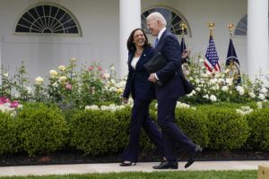 ASSOCIATED PRESS                                 President Joe Biden walks with Vice President Kamala Harris after speaking on updated guidance on face mask mandates and COVID-19 response, in the Rose Garden of the White House, today, in Washington.